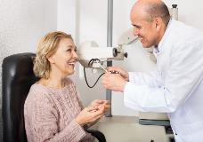 Male optician and patient
