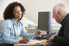 A GP talks to her patient