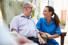 A nurse visiting a patient
