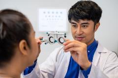 Optometrist helping a customer