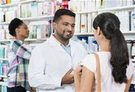 Pharmacist advising a customer