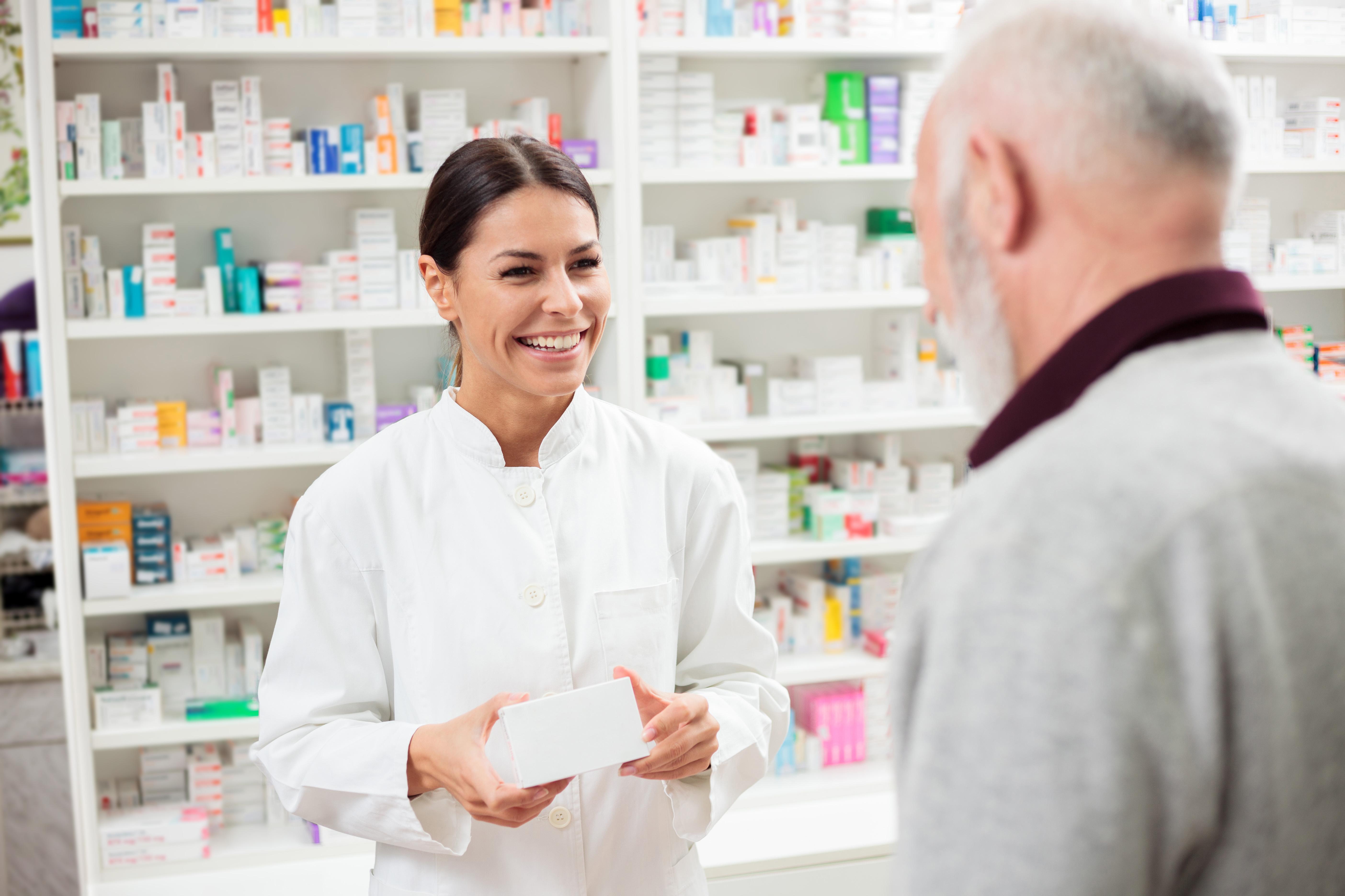 Pharmacist serving customer