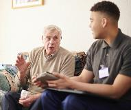 Social worker talking to a client